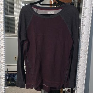 Maroon and grey crew neck with zippers on side